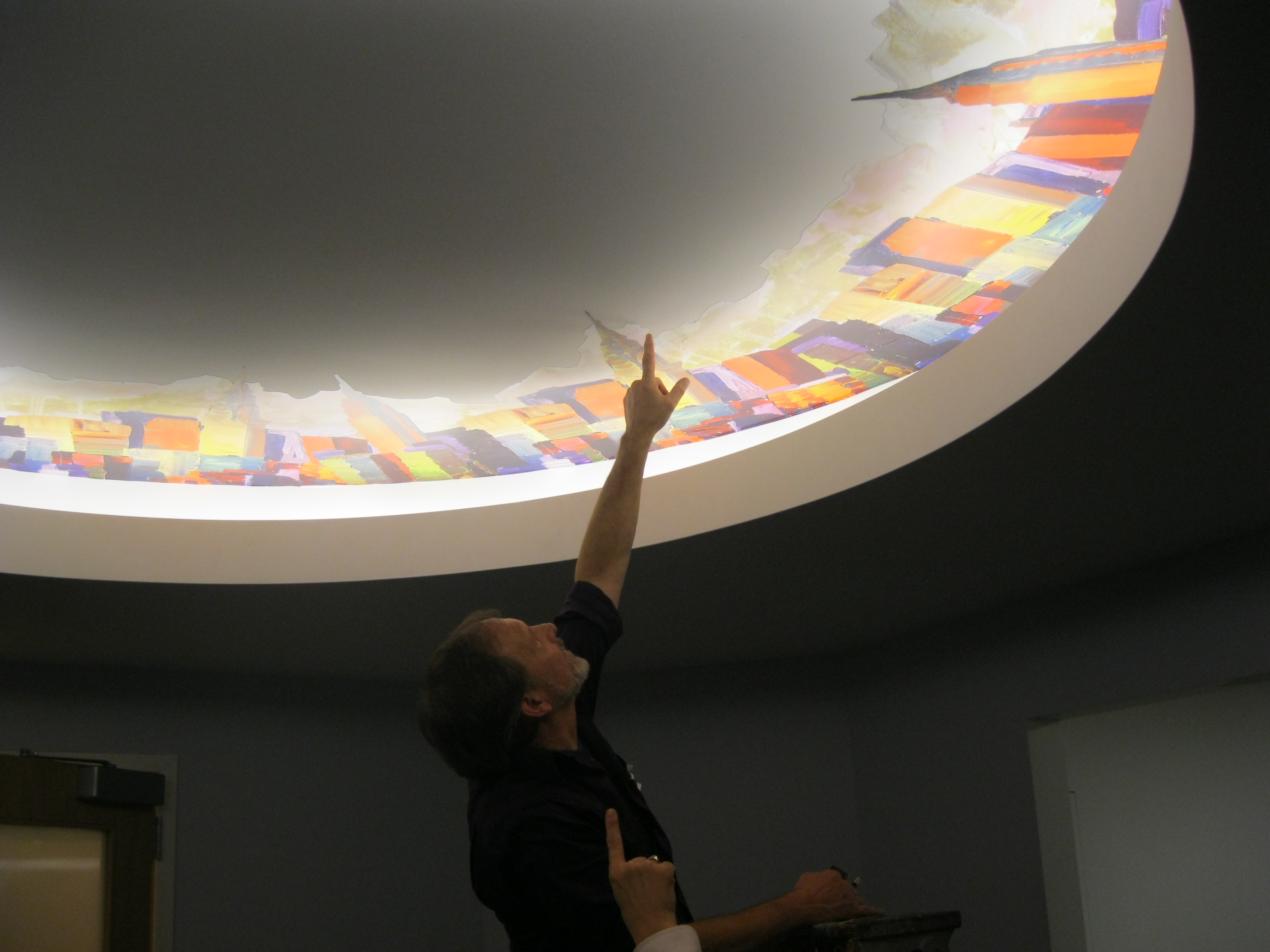 applying adhesive vynil for cove ceiling artwork